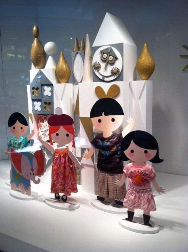 "International theme ""It's a small world"" window display with doll like figurines."
