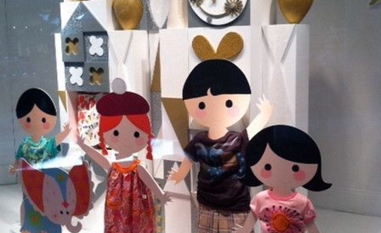 "International theme ""It's a small world"" window display with doll like figurines."