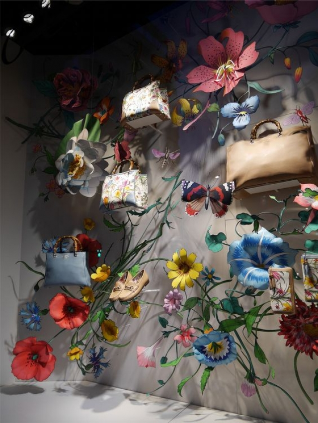 Gucci visual merchandising display with beautiful flower and nature decorations.