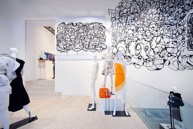 Doodles on the walls and white mannequins in moving positions is what you can observe from this Joyce display, in Hong Kong - China.