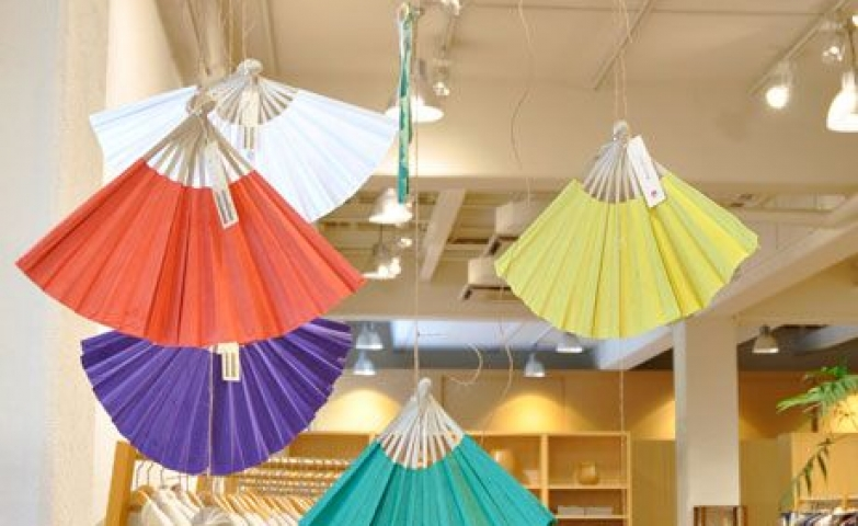 Clothes shop decoration made with hanged colored fans seen in Tokyo, Japan.