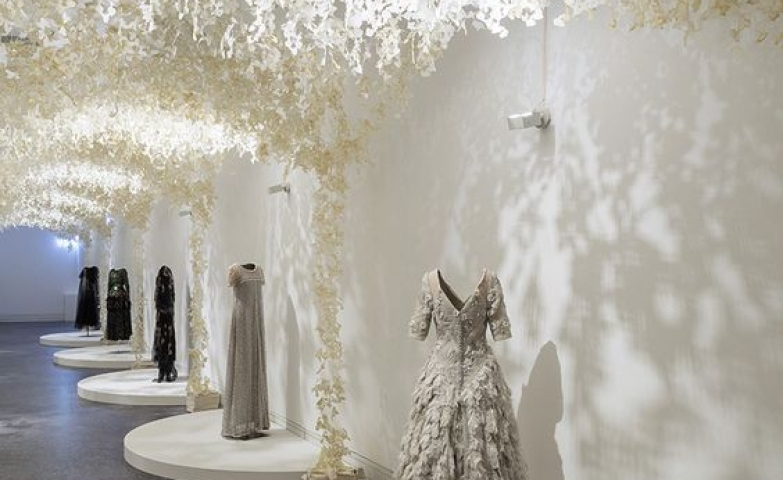 Beautiful palace paper design for the display of these exquisite dresses in Barcelona.