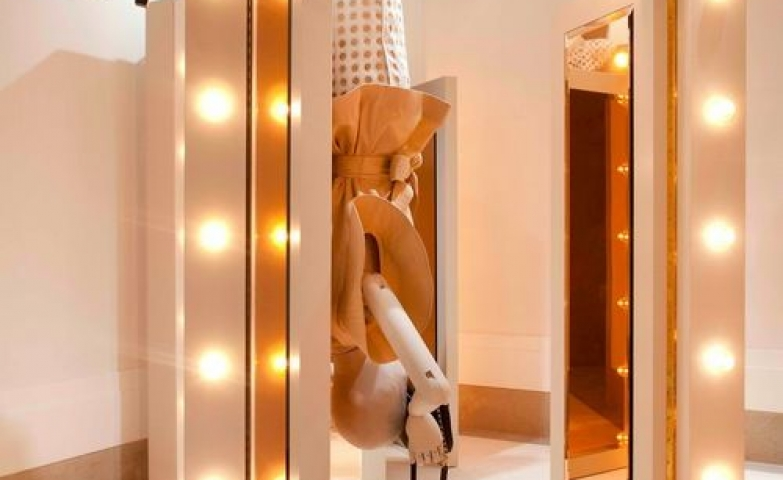 Very creative display with a mannequin hanging upside down to take a photo, by Chloe's new flagship store in Paris.