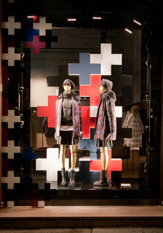 Colored crosses glued randomly together seen in the windows of Milan during Peuterey Fashion Week.