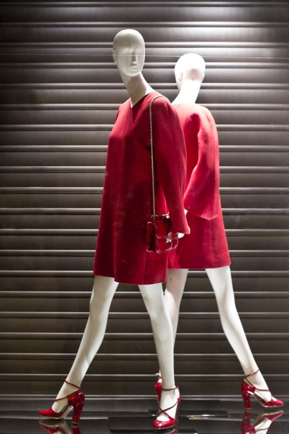 Simple window display for visual merchandising by Valentino, puts the spotlight on the vivid red dress.