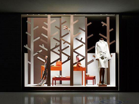 Simple shaped, bright orange and white used for this Hermés display windows by Nendo, in Japan.