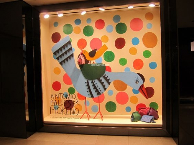 This window from Loewe takes us back to childhood with these illustrations and uneven colored circles. Visual merchandising seen in Hong Kong.