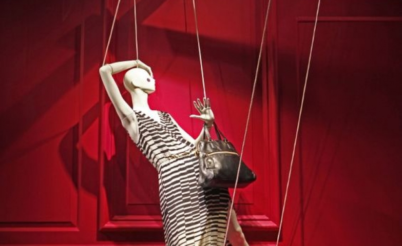 Clever idea for a window display featuring a mannequin from Saks seen on Fifth Avenue in New York.