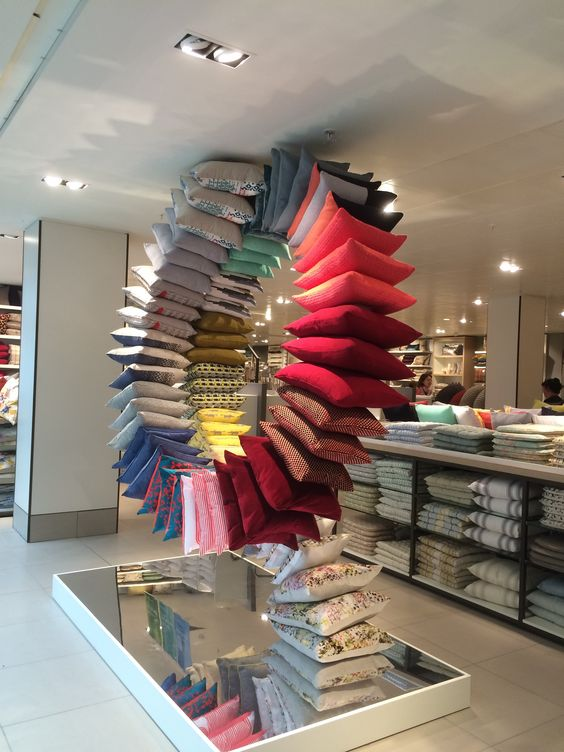 A rainbow of pillows displayed in the store of John Lewis on Oxford Street, London.