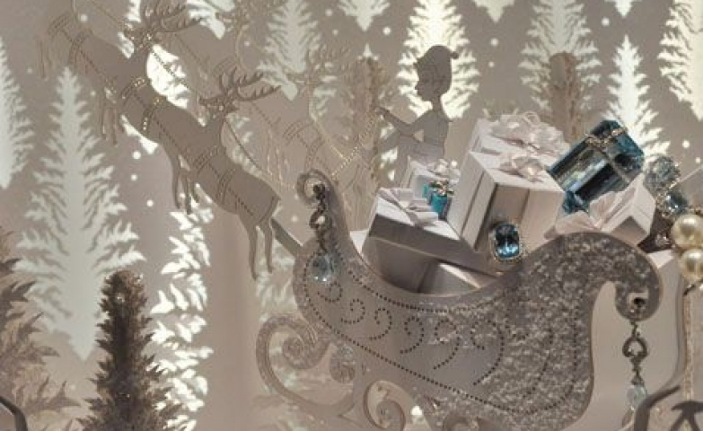 "Theme ""The faithful shopper countdown to Christmas"" with magical decor, reindeer, all white decor."