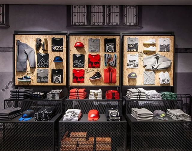 Street inspired merchandise display on stands and walls, from Nike Kicks Lounge in Shanghai - China.