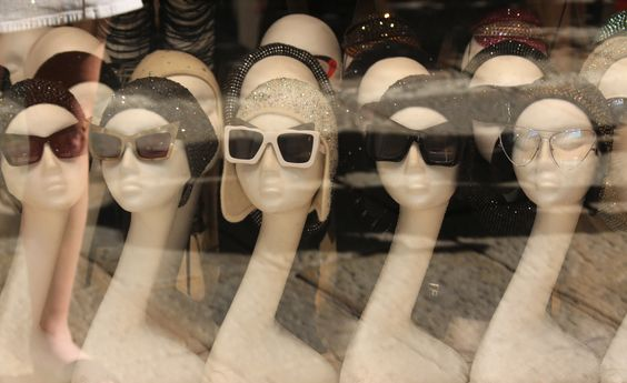 Oddly shaped long neck mannequin heads for used for the display of a sunglasses store in Milan, Italy.