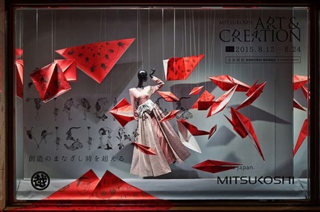 Beautiful origami inspired visual merchandising design, with accent on the color red. Seen in Japan.