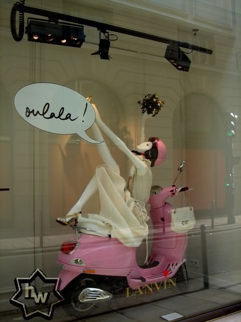 Lanvin really goes for distinct props, in this one they used a pink Vespa and white merchandise.
