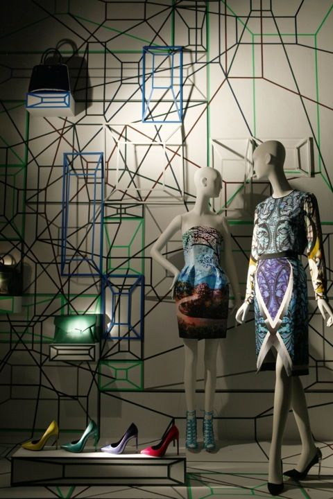 Visual merchandising display with geometric theme, windows by Bergdorf Goodman.