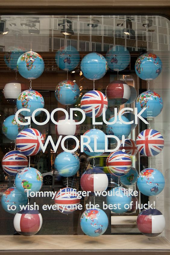Global support visual merchandising display theme by Tommy Hilfiger in London.