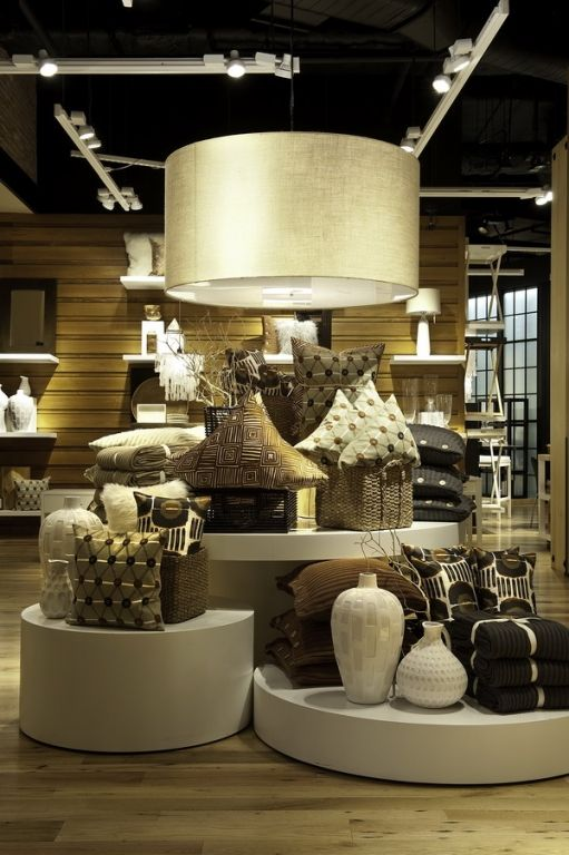 West Elm visual merchandising display with cylindrical stands and nude colors seen in New York.