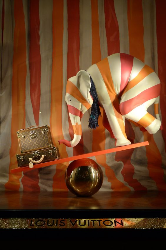 Another circus themed Louis Vuitton window, in this one the elephant is balancing on a mirrored sphere.