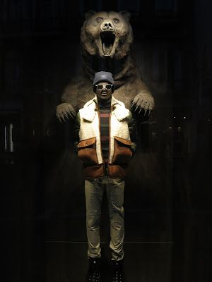 Moncler gruesome visual merchandising display with a giant real sized bear seen in London.