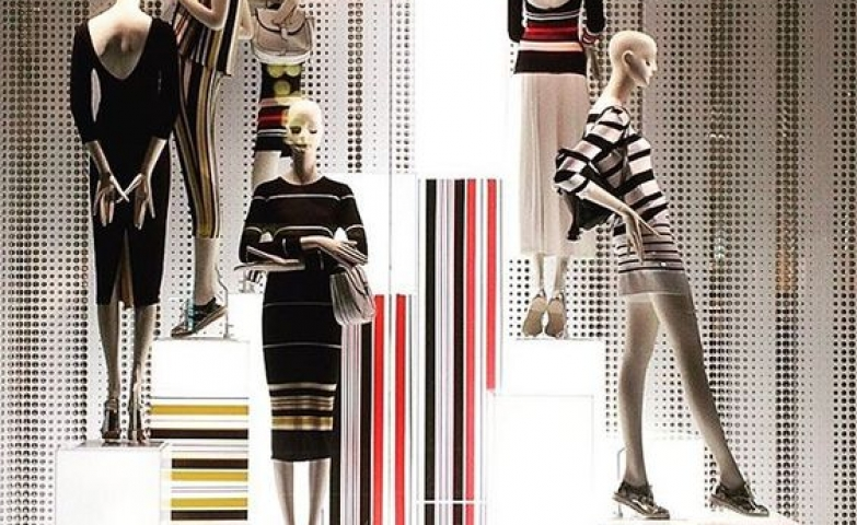 Stripes inspired visual display with lighted stands for the window of Zara in Rome, Italy.