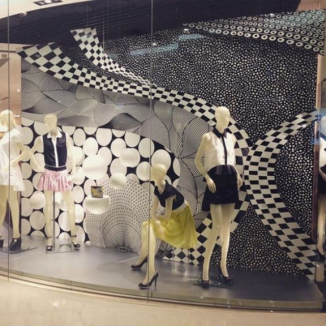 Pattern inspiration for a window display design setting, from a visual merchandising display in China.