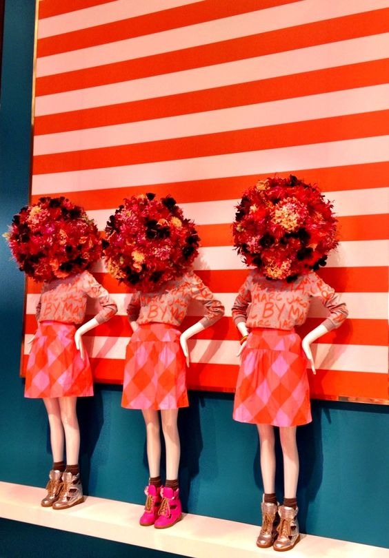 Flower and stripes display with bright red color shades for Marc Jacobs, seen at Printemps in Paris.