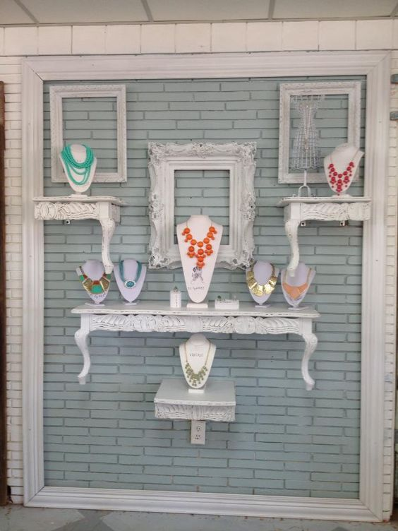 New jewelry wall display created at De'France using props like photo frames and stands that look like tables.