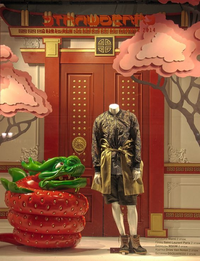 Window display in China focused on Chinese recognizable elements and a funny dragon shaped strawberry.