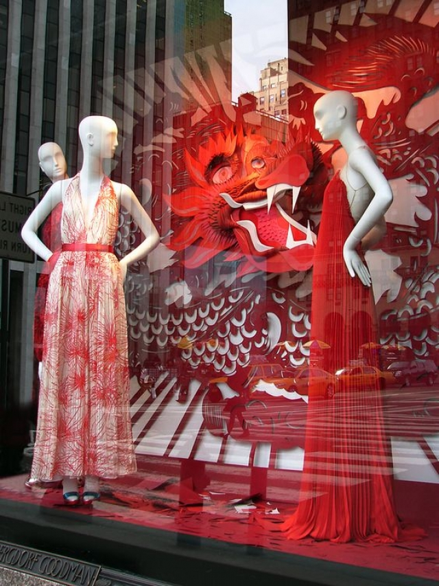 Visual merchandising based on the color red and red Chinese dragon used to create a beautiful window display, seen in China.