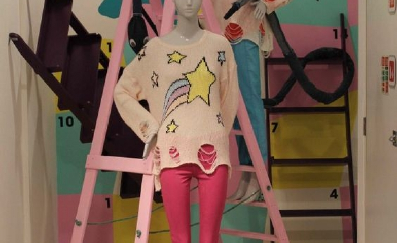Selfridges playful display, with retro pastel colors and childish designs in London.