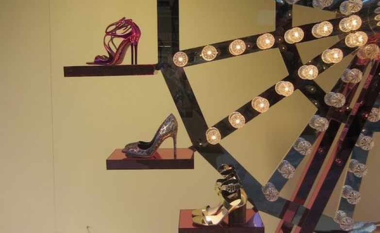 Shoe carnival theme with shoes displayed on a carnival wheel at Selfridges, London.