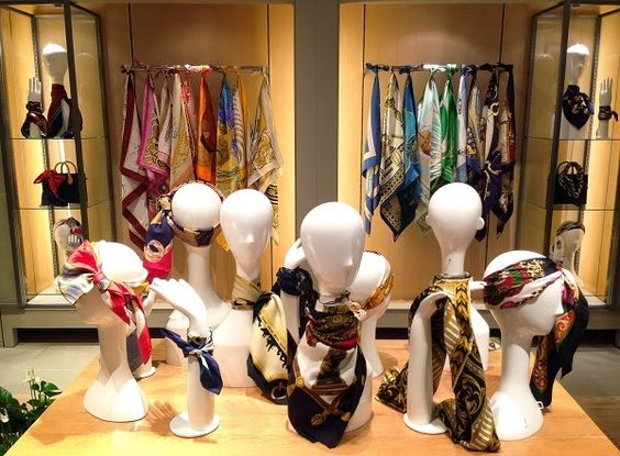 """""""The vintage scarf collection"""" visual merchandise displayed on mannequin heads in Shibuya, Japan."""