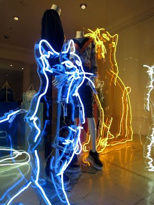 Stella McCartney neon cat figures  used for a visual merchandising display in London.