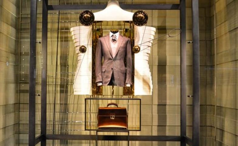 "Visual merchandising display window themed  ""Reflective Statements: Hugo Boss, Ermenegildo Zegna, Louis Vuitton & Rag & Bone"" seen in London."