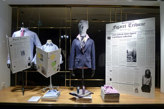 Alain Figaret window display using newspapers as props to focus on the business look of the displayed merchandise.