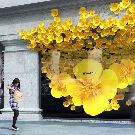 When the Apple store opened in London, it went for a bright yellow flower window display to catch everyone's attention.