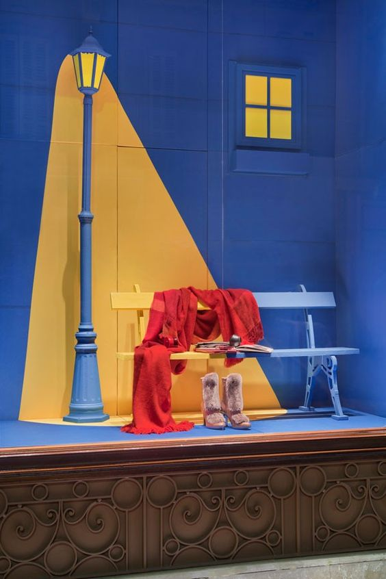 Artistic window display looks like a painting, with contrasting blue and yellow colors for Hermes.