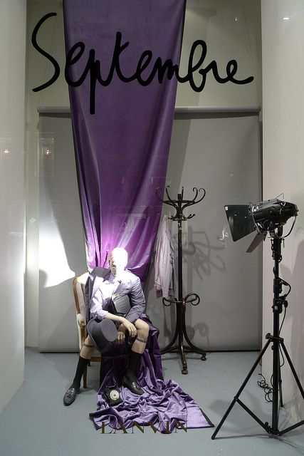 This window look very ordinary, yet that is exactly what makes it beautiful. Lilac curtain, movie lights, a coats hanger and a mannequin. Vitrine design for Lanvin.