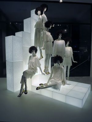 Zara minimalist display with lighted stands and all white merchandise seen in London.