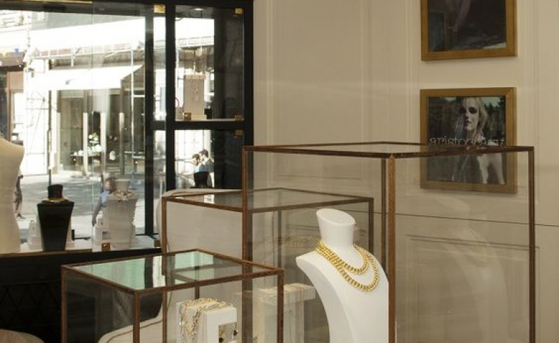 Glass cubes give an elegant look to the display of gold jewelry, interior from the Aristocrazy Jewellery Store in Porto.