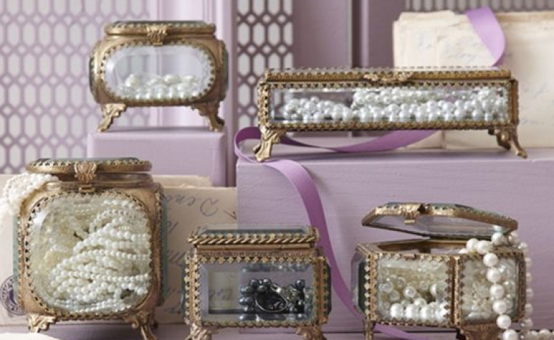 Beautiful transparent glass and gold metal antique jewelry boxes.