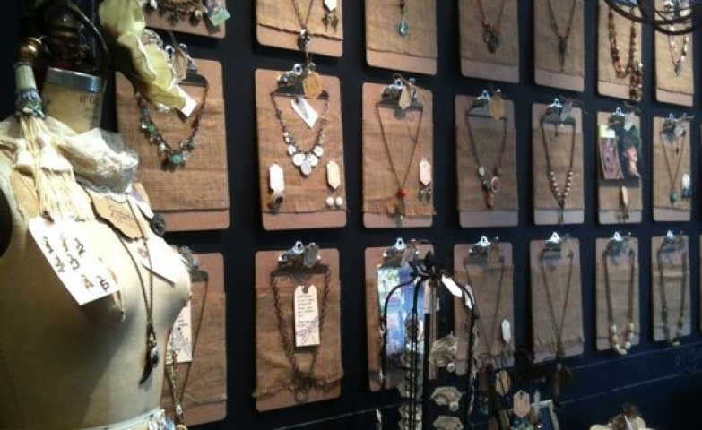Neutral wood clipboards arranged in rows for the use of artfully displayed necklaces, ingenious jewelry display solution.