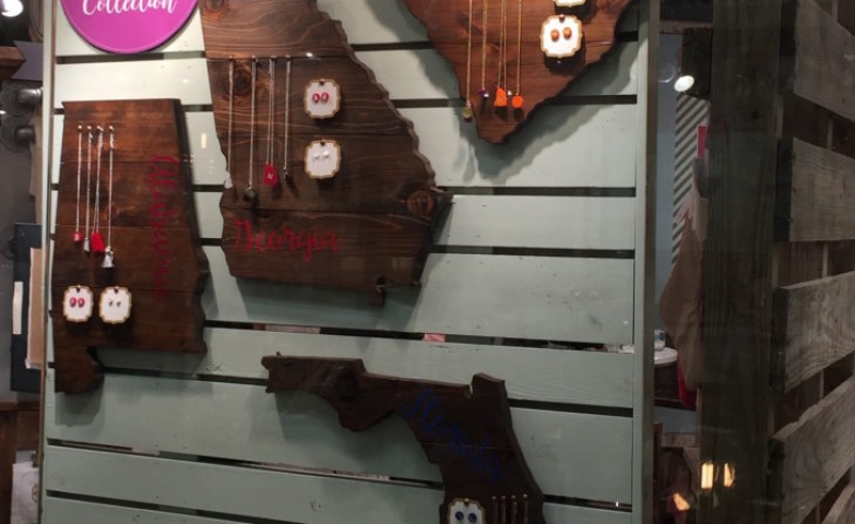Oddly shaped wooden pieces hanged on a wall and used to display various jewelry.