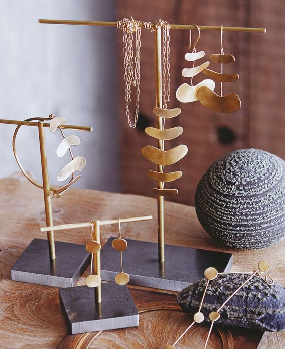 For those brass plated classic jewelry is this display design stand a playful and simple idea.