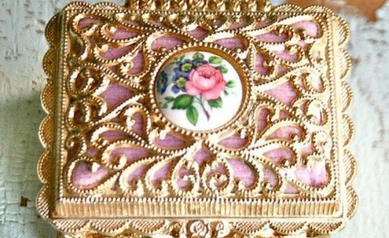 Beautiful trinket box with gold and pink detail and a pink rose on top.