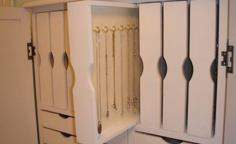 Best jewelry cabinet ever with vertical and horizontal drawers, white finish.