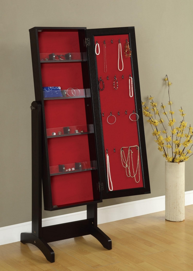 This piece is a black mirror jewelry armoire with a single door and shelves for keeping different jewelry.