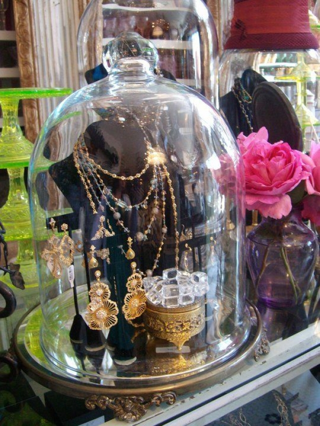Cloche jewelry display bring a vintage feeling accompanied by some vivid roses.