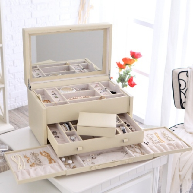 White box with mirror and plenty of compartments for jewelry.