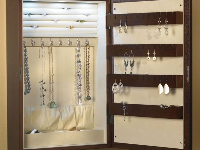 Idea for a built in jewelry armoire, made from wood and with plenty of storage solutions.